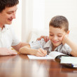 Father helping son do homework — Stock Photo #8482014