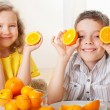 Children with oranges — Stock Photo