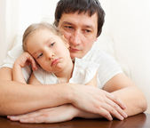 Father comforts a sad girl — Stock Photo
