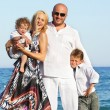 Family on beach — Stock Photo #8602700