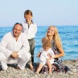 Family on beach — Stock Photo #8602712