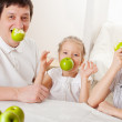 Family with apples — Stock Photo #8703914
