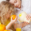 Children with oranges — Stock Photo #8834451