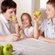 Family with apples — Stock Photo #8834464