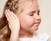 Girl has a sore ear — Stock Photo