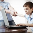 Royalty-Free Stock Photo: Father dragging son from the computer