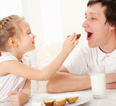 Child with father have a breakfast — Stock Photo
