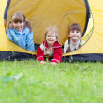 Children in tent — Stock Photo #9336578