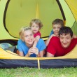Family in tent — Stock Photo #9336579