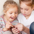 Surprised children with mobile phone — Stock Photo #9541928