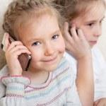 Children talking on mobile phone — Stock Photo #9541934