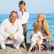 Family on beach — Stock Photo #9668238