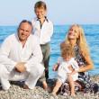 Family on beach — Stock Photo