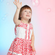 Child playing with soap bubbles — Stock Photo