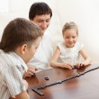 Family that plays dominoes — Stock Photo