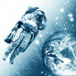 Cosmonaut flying to the earth - Stock Photo
