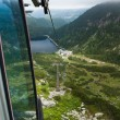 Cable car in alps over the mountains — Stock Photo