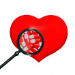 Red heart with black magniglass — Stock Photo