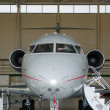 Private Jet in hangar — Stock Photo #9660996