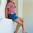 Little girl in shorts sitting — Stock Photo #10023215