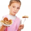 Little girl holding plate of meatballs — Stock Photo #10023223