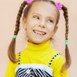 Little girl in yellow dress — Stock Photo