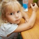 Little girl eating chocolate bar — Stock Photo
