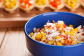 Tartlets with crab salad and corn — Stock Photo
