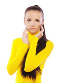 Beautiful woman in yellow turtleneck — Stock Photo