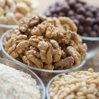 Walnuts, cashews, sesame seeds, pine nuts - Stock Photo