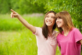 Two young pretty girls in a park — Stock Photo