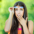 Woman closes his hand in surprise mouth — Stock Photo