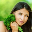 Woman with bare shoulders holding bunch of parsley — Stock Photo #10378564