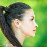 profil twarz młodej kobiety piękne — Zdjęcie stockowe #10378572