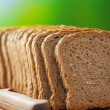 Cut rye bread and knife - Stock Photo