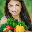 Woman with bare shoulders holding vegetable — Foto de Stock