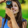 Woman photographed with camera and smiling — Stock Photo