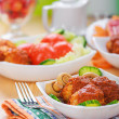 Meat cutlets with cucumber and mushrooms - Stock Photo