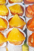 Tasty little tarts with pineapple and mandarin — Stock Photo