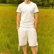 Handsome young man dressed in white — Stock Photo