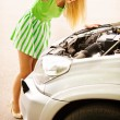 Young woman repairing car - Photo