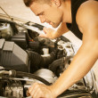 Young man repairing car — Stock Photo #10536092