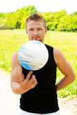 Brave man turns on his finger volleyball — Stock Photo