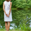 Young woman near lake - Stock Photo