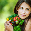 Woman with bare shoulders holding vegetable — ストック写真