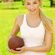 Beautiful young sportswoman with rugby ball — Stock Photo #10561315