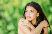 Beautiful woman with bare shoulders crossed her arms — Stock Photo