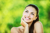 Woman with bare shoulders laughs and looks up — Stock Photo