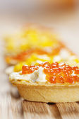 Tartlets with caviar and corn — Stock Photo