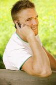 Young man talk on mobile phone — Stock Photo